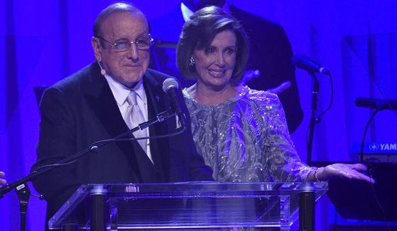 Clive Davis, left, and Nancy Pelosi on stage at the Clive Davis and The Recording Academy Pre-Grammy Gala at the Beverly Hilton Hotel on Saturday, Feb. 11, 2017, in Beverly Hills, Calif. (Photo by Chris Pizzello/Invision/AP)