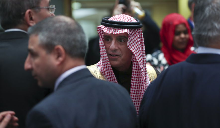 Saudi Arabia's Foreign Minister Adel Al-Jubeir, centre, talks to counterparts during an EU-Arab League ministerial meeting at the European Council headquarters in Brussels, Monday, Feb. 4, 2019. (AP Photo/Francisco Seco)