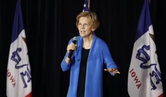 Sen. Elizabeth Warren, D-Mass., speaks to local residents during an organizing event, Sunday, Feb. 10, 2019, in Cedar Rapids, Iowa. (AP Photo/Charlie Neibergall)