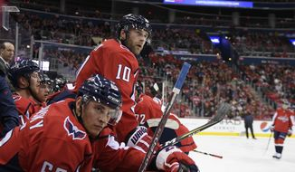 Washington Capitals right wing Brett Connolly (10) and left wing Andre Burakovsky (65) watch from the bench during the first period of an NHL hockey game against the Florida Panthers, Saturday, Feb. 9, 2019, in Washington. (AP Photo/Nick Wass) ** FILE **