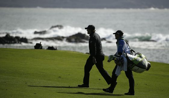Phil Mickelson, left, walks with his brother and caddie Tim Mickelson up the fourth fairway of the Pebble Beach Golf Links during the final round of the AT&T Pebble Beach Pro-Am golf tournament Sunday, Feb. 10, 2019, in Pebble Beach, Calif. (AP Photo/Eric Risberg)