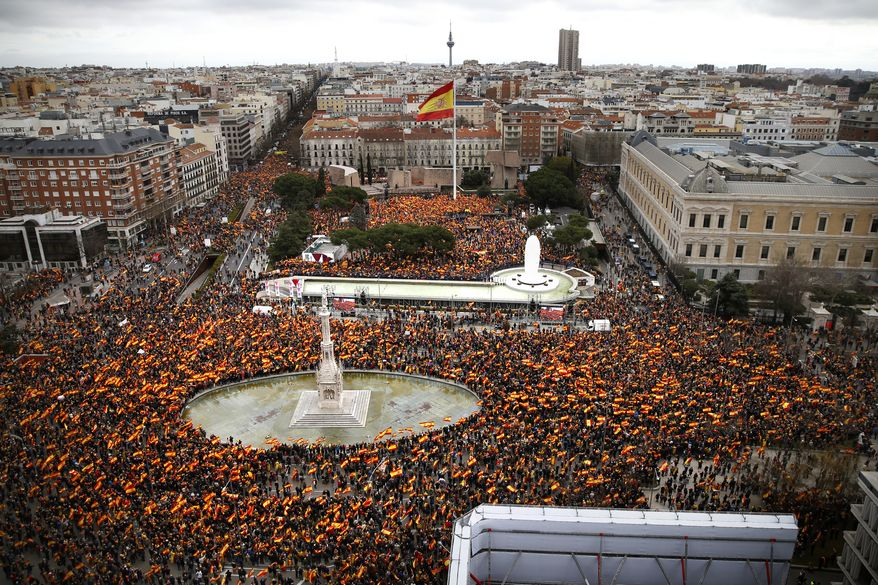 Thousands of demonstrators hold Spanish flags during a protest in Madrid, Spain, on Sunday, Feb.10, 2019. Thousands of Spaniards in Madrid are joining a rally called by right-wing political parties to demand that Socialist Prime Minister Pedro Sanchez step down. (AP Photo/Andrea Comas)
