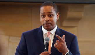 Virginia Lt. Gov. Justin Fairfax gestures during remarks before a meeting of the campaign to reduce evictions at a church meeting room in Richmond, Va.  (AP Photo/Steve Helber) ** FILE **