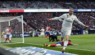 Real Madrid's Gareth Bale celebrates after scoring his side's 3rd goal during a Spanish La Liga soccer match between Atletico Madrid and Real Madrid at the Metropolitano stadium in Madrid, Spain, Saturday, Feb. 9, 2019. (AP Photo/Manu Fernandez)