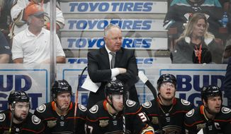 FILE - In a Wednesday, Jan. 23, 2019 file photo, Anaheim Ducks coach Randy Carlyle, center, watches during the third period of the team's NHL hockey game against the St. Louis Blues, in Anaheim, Calif. The Anaheim Ducks have fired coach Randy Carlyle amid a seven-game losing streak. The Ducks announced Sunday, Feb. 10, 2019  that general manager Bob Murray would take over as interim coach for the remainder of the regular season.  (AP Photo/Jae C. Hong, File) **FILE**