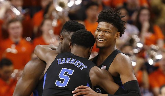 Duke's Zion Williamson, left, RJ Barrett (5) and Cam Reddish celebrate the team's 81-71 victory over Virginia during an NCAA college basketball game in Charlottesville, Va., Saturday, Feb. 9, 2019. (Mark Gormus/Richmond Times-Dispatch via AP) **FILE**