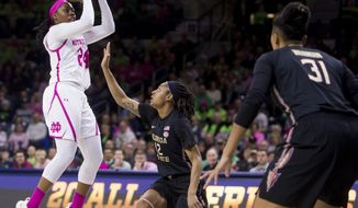 Notre Dame's Arike Ogunbowale (24) shots in front of Florida State's Nicki Ekhomu (12) during the first half of an NCAA college basketball game Sunday, Feb. 10, 2019, in South Bend, Ind. (AP Photo/Robert Franklin)