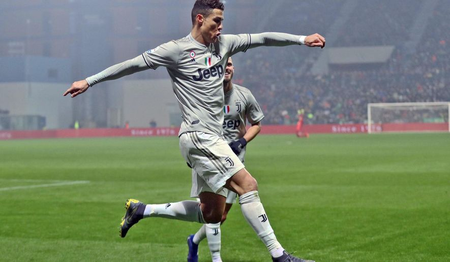 Juventus' Cristiano Ronaldo celebrates after scoring his side's second goal during series soccer match between Sassuolo and Juventus, at the Mapei Stadium in Reggio Emilia, Italy, Sunday, Feb. 10, 2019. (Elisabetta Baracchi/ANSA via AP)