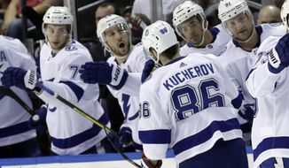 Tampa Bay Lightning right wing Nikita Kucherov (86) is congratulated after scoring a goal during the first period of an NHL hockey game against the Florida Panthers, Sunday, Feb. 10, 2019, in Sunrise, Fla. (AP Photo/Lynne Sladky)