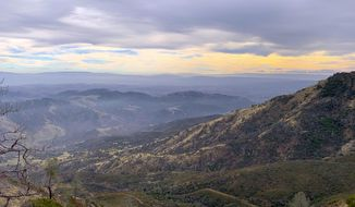 In this Dec. 18, 2018 photo, the view from the North Ridge Trail on Mount Diablo looks southwest, in Mount Diablo State Park, Calif. Authorities say a body has been found in the wreckage of a plane they believed crashed Friday night, Feb. 8, 2019, two miles southwest of the peak of Mount Diablo in Northern California. (Tom Stienstra/San Francisco Chronicle via AP)