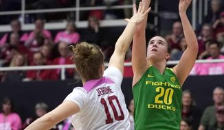 Oregon guard Sabrina Ionescu (20) shoots over Stanford forward Alyssa Jerome (10) during the first half of an NCAA college basketball game Sunday, Feb. 10, 2019, in Stanford, Calif. (AP Photo/Tony Avelar)