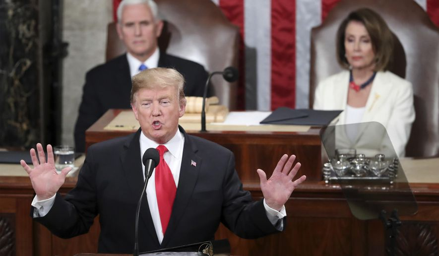 "In this Feb. 5, 2019 photo, President Donald Trump delivers his State of the Union address to a joint session of Congress on Capitol Hill in Washington, as Vice President Mike Pence and Speaker of the House Nancy Pelosi, D-Calif., watch. In his State of the Union, President Donald Trump said a ""powerful barrier"" had cut crime rates and turned El Paso, Texas, from one of the nation's most dangerous cities to one of its safest. But many in El Paso, site of Trump's rally Monday night, say the city was safe for decades and embodies a cross-border spirit that transcends walls rather than prove they work.  (AP Photo/Andrew Harnik)"