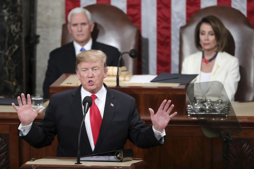 """In this Feb. 5, 2019 photo, President Donald Trump delivers his State of the Union address to a joint session of Congress on Capitol Hill in Washington, as Vice President Mike Pence and Speaker of the House Nancy Pelosi, D-Calif., watch. In his State of the Union, President Donald Trump said a """"powerful barrier"""" had cut crime rates and turned El Paso, Texas, from one of the nation's most dangerous cities to one of its safest. But many in El Paso, site of Trump's rally Monday night, say the city was safe for decades and embodies a cross-border spirit that transcends walls rather than prove they work.  (AP Photo/Andrew Harnik)"""