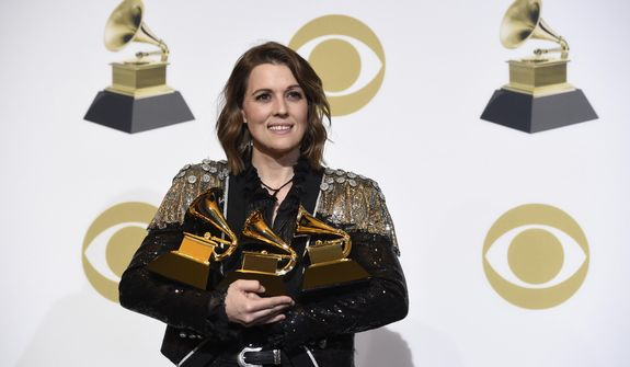 "Brandi Carlile, winner of the awards for best Americana album for ""By The Way, I Forgive You"", best American roots performance for ""The Joke"", and best American roots song for ""The Joke"" poses in the press room at the 61st annual Grammy Awards at the Staples Center on Sunday, Feb. 10, 2019, in Los Angeles. (Photo by Chris Pizzello/Invision/AP)"