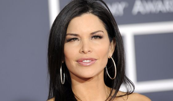 Lauren Sanchez arrives at the Grammy Awards on Sunday, Jan. 31, 2010, in Los Angeles. (AP Photo/Chris Pizzello)