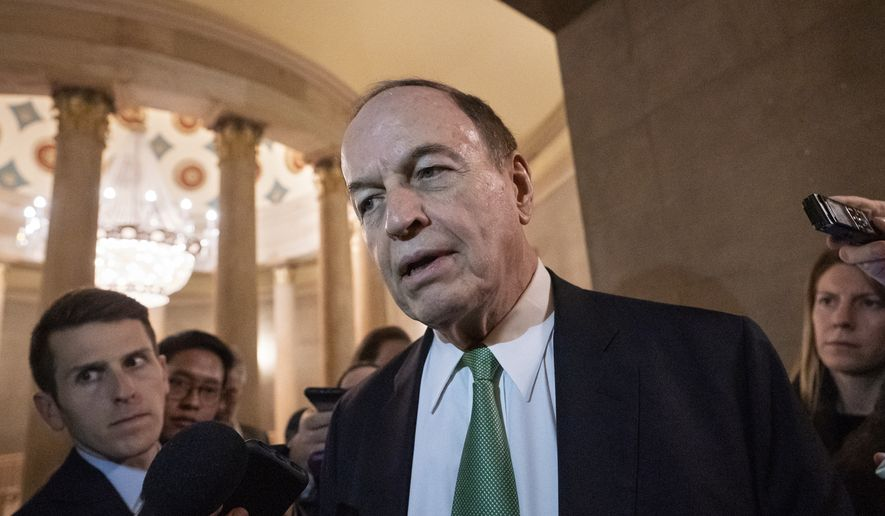 Sen. Richard Shelby, R-Ala., chair of the Senate Appropriations Committee, pauses for reporters as he and other senior bipartisan House and Senate negotiators try to strike a border security compromise in hope of avoiding another government shutdown, at the Capitol in in Washington, Monday, Feb. 11, 2019. (AP Photo/J. Scott Applewhite)