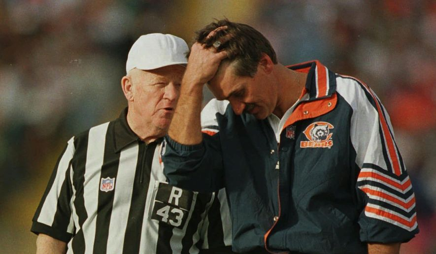 National Football League official Red Cashion, left, is shown talking to Chicago Bears head coach Dave Wannstedt, during the Bears Broncos game in Denver on Sunday, Nov. 10, 1996. After 500 NFL games, and hundreds more of college and high school games, a football season is starting and Cashion won't be on the field as an official. Cashion, an official since 1951, retired after the 1996 NFL season. (AP Photo/David Zalubowski) **FILE**