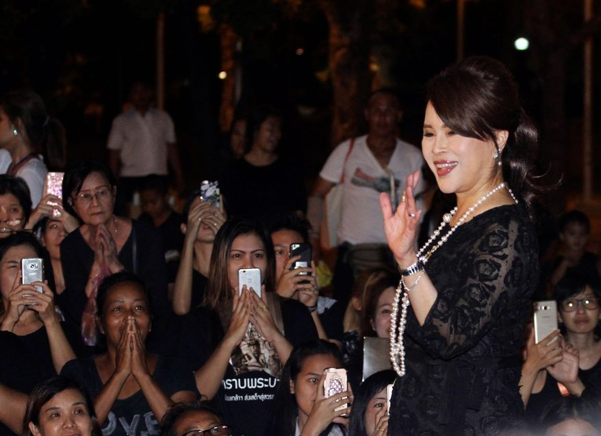 In this Oct 27, 2017, file photo, Thai Princess Ubolratana Mahidol waves to Thai people outside Grand Palace in Bangkok , Thailand. Thai Raksa Chart party on Friday, Feb. 8, 2019, named the princess as its nominee to be the next prime minister, upending tradition of the palace eschewing politics and upsetting all predictions about what might happen in next month's elections. (AP Photo)