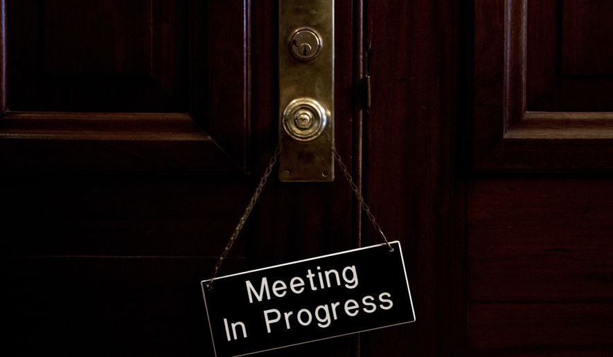 "A sign that reads ""Meeting In Progress"" hands on a door of a closed meeting room at the Capitol as bipartisan House and Senate bargainers trying to negotiate a border security compromise in hope of avoiding another government shutdown on Capitol Hill, Monday, Feb. 11, 2019, in Washington. (AP Photo/Andrew Harnik)"