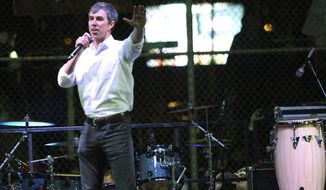 Former Democratic Rep. Beto O'Rourke speaks to a crowd inside a ball park across the street from where President Donald Trump was holding a rally inside the El Paso County Coliseum in El Paso, Texas, Monday, Feb. 11, 2019. (AP Photo/Rudy Gutierrez)