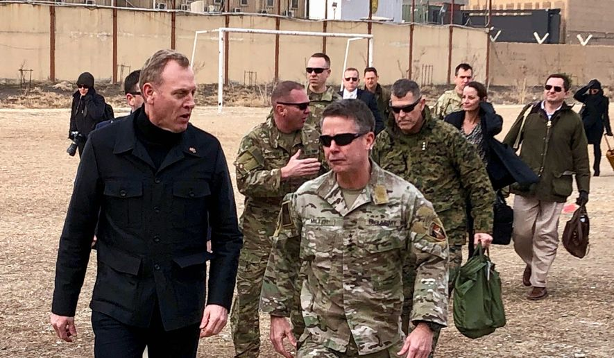 Acting Defense Secretary Pat Shanahan, left, arrives in Kabul, Afghanistan, Monday morning, Feb. 11, 2019, to consult with Army Gen. Scott Miller, right, commander of U.S. and coalition forces, and senior Afghan government leaders. The unannounced visit is the first for the acting secretary of defense, Pat Shanahan. He previously was the No. 2 official under Jim Mattis, who resigned as defense chief in December. (AP Photo/Robert Burns)