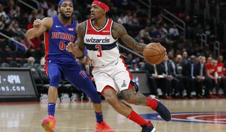 Washington Wizards guard Bradley Beal (3) drives on Detroit Pistons guard Bruce Brown (6) during the second half of an NBA basketball game, Monday, Feb. 11, 2019, in Detroit. (AP Photo/Carlos Osorio) ** FILE **