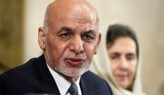 FILE - In this Nov. 28, 2018 file photo, Afghan president Ashraf Ghani delivers a speech during the United Nations Conference on Afghanistan at the UN Offices in Geneva, Switzerland. Ghani says the Taliban are welcome to set up a political office in the Kabul but that his government must be included in any peace talks. In a speech Monday, Feb. 11, 2019, he rejected the idea of an interim government, which has been embraced by the Taliban and some opposition figures, vowing that elections will he held as planned later this year. (Fabrice Coffrini/pool photo via AP, File)