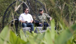 "FILE- In this Sept. 12, 2018 file photo, Republican candidate for Florida Governor Ron DeSantis, left, chats with Ron Bergeron during an airboat tour of the Florida Everglades, in Fort Lauderdale, Fla. Gov. Ron DeSantis appointed Ron ""Alligator Ron"" Bergeron to the South Florida Water Management District board February 1, 2019, a position responsible for flood protection, Everglades restoration and water policy for 16 counties. (AP Photo/Wilfredo Lee, File)"
