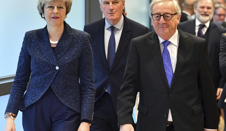 European Commission President Jean-Claude Juncker, British Prime Minister Theresa May and European Union chief Brexit negotiator Michel Barnier, center, walk to their meeting at the European Commission headquarters in Brussels, Thursday, Feb. 7, 2019. (AP Photo/Geert Vanden Wijngaert)