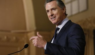 FILE - In this Jan. 17, 2019 file photo, Gov. Gavin Newsom speaks at the California Legislative Black Caucus Martin Luther King Jr., Breakfast, in Sacramento, Calif. Newsom is withdrawing several hundred National Guard troops from the nation's southern border and changing their mission. (AP Photo/Rich Pedroncelli, File)
