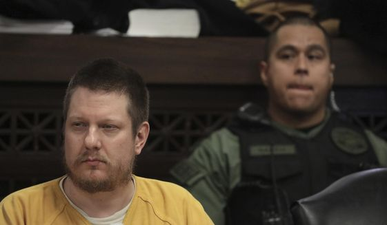 In this Jan. 18, 2019, file photo, former Chicago police Officer Jason Van Dyke attends his sentencing hearing at the Leighton Criminal Court Building in Chicago, for the 2014 shooting of Laquan McDonald. Illinois' attorney general is holding a news conference with the prosecutor who won a conviction against the white Chicago police officer who killed black teenager Laquan McDonald. Neither Attorney General Kwame Raoul nor Kane County State's Attorney Joseph McMahon have said what Monday's news conference is about. It comes after Raoul's office signaled that it may ask the Illinois Supreme Court to intervene over what prosecutors see as a too lenient sentence for Jason Van Dyke. (Antonio Perez/Chicago Tribune via AP, Pool, File)