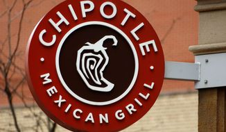 This Jan. 12, 2017, file photo shows the sign on a Chipotle restaurant in Pittsburgh. Chipotle is teaming up with Oscar-winning documentary filmmaker Errol Morris for a series of ads touting its fresh ingredients. (AP Photo/Gene J. Puskar, File)