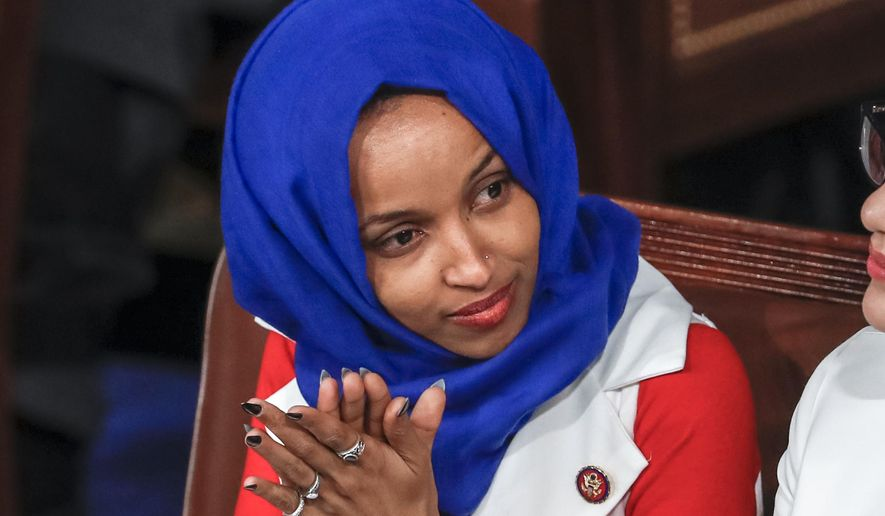 """In this Feb. 5, 2019, file photo, Rep. Ilhan Omar, D-Minn., listens to President Donald Trump's State of the Union speech, at the Capitol in Washington. Omar """"unequivocally"""" apologized Monday, Feb. 11, 2019, for tweets suggesting that members of Congress support Israel because they are being paid to do so, which drew bipartisan criticism and a rebuke from House Speaker Nancy Pelosi. (AP Photo/J. Scott Applewhite, File)"""