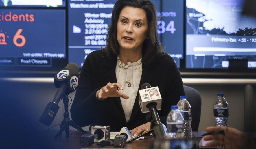 In this Jan. 31, 2019, file photo, Michigan Gov. Gretchen Whitmer speaks to the media at the Michigan State Police headquarters in Dimondale, Mich. The first tussle between the Democratic Governor and the Republican-led Legislature isn't over how to fix the roads, overhaul school funding or tackle the state's high car insurance premiums. Instead, they're clashing over the environment _ specifically how Michigan adopts regulations and permit requirements for businesses and citizens. Whitmer recently abolished panels created last year. Now GOP lawmakers may reject her order. (Matthew Dae Smith/Lansing State Journal via AP, File)
