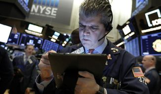 FILE- In this Feb. 5, 2019, file photo trader John Panin works on the floor of the New York Stock Exchange. The U.S. stock market opens at 9:30 a.m. EST on Monday, Feb. 11. (AP Photo/Richard Drew, File)
