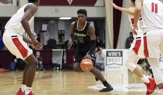 "FILE - In this Jan. 20, 2019, file photo, Holy Spirit Prep's Anthony Edwards (5), center, plays against Long Island Lutheran during a high school basketball game at the Hoophall Classic in Springfield, Mass.  Edwards, rated as the nation's No. 2 prospect, says he will sign with Georgia. Edwards, whose nickname is ""Ant Man,"" made the announcement Monday morning, Feb. 11, 2019, at his school in Atlanta. (AP Photo/Gregory Payan, File)"