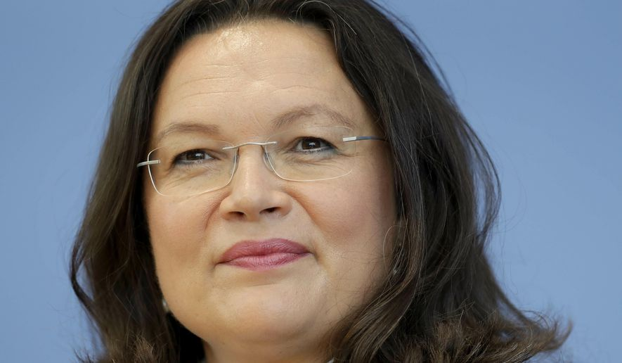 File---In this picture taken Tuesday, June 27, 2017 leader of Germany's Social Democrats Andrea Nahles is seen during a press conference of the German Social Democratic Party (SPD) in Berlin, Germany,  (AP Photo/Michael Sohn)