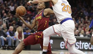 Cleveland Cavaliers' Collin Sexton (2) drives to the basket against New York Knicks' Kevin Knox (20) in the first half of an NBA basketball game, Monday, Feb. 11, 2019, in Cleveland. (AP Photo/Tony Dejak)