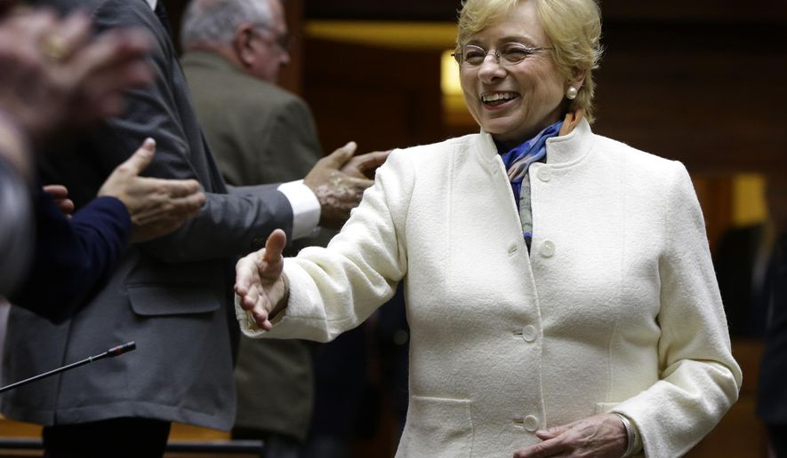 Gov. Janet Mills arrives in the House Chamber prior to delivering her State of the Budget address to the Legislature, Monday, Feb. 11, 2019, at the State House in Augusta, Maine. (AP Photo/Robert F. Bukaty)