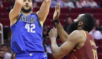 Dallas Mavericks forward Maximilian Kleber (42) shoots as Houston Rockets guard James Harden defends during the first half of an NBA basketball game, Monday, Feb. 11, 2019, in Houston. (AP Photo/Eric Christian Smith)