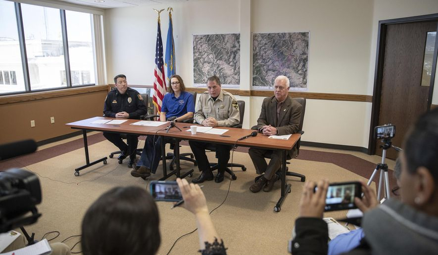 Rapid City Police Chief Karl Jageris, from left, Pennington County Search and Rescue team leader Tammy Stadel, Pennington County Sheriff Kevin Thom and Children's Home Society executive director Bill Colson appear at a news conference Monday, Feb. 11, 2019, at the Rapid City, S.D., Public Safety Building to discuss the efforts so far in the search for Serenity Dennard, a 9-year-old girl who ran away from a residential youth home in western South Dakota last weekend. (Ryan Hermens/Rapid City Journal via AP)