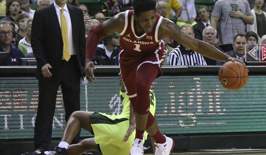 Oklahoma guard Rashard Odomes (1) comes up with a steal over Baylor guard Jared Butler (12) in the first half of an NCAA college basketball game, Monday, Feb. 11, 2019, in Waco, Texas. (Rod Aydelotte/Waco Tribune-Herald via AP)