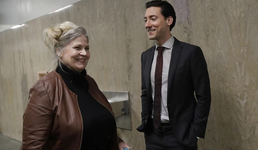 Sandra Merritt, left, smiles as she talks with David Daleiden outside of a courtroom in San Francisco, Monday, Feb. 11, 2019. Planned Parenthood has made an unusual legal demand to join California's criminal prosecution of two anti-abortion activists charged with invasion of privacy for secretly making videos as they tried to buy fetal material from the organization.(AP Photo/Jeff Chiu)