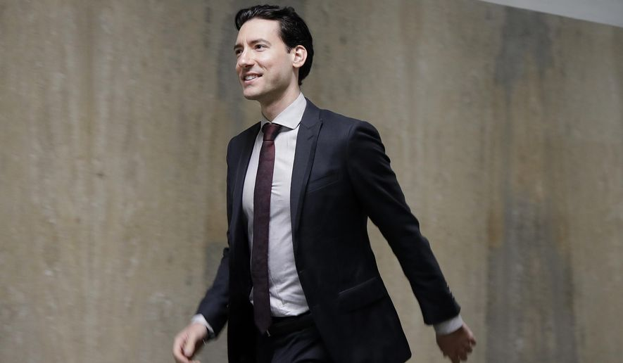 David Daleiden walks outside of a courtroom in San Francisco, Monday, Feb. 11, 2019. Planned Parenthood has made an unusual legal demand to join California's criminal prosecution of two anti-abortion activists charged with invasion of privacy for secretly making videos as they tried to buy fetal material from the organization. (AP Photo/Jeff Chiu) **FILE**