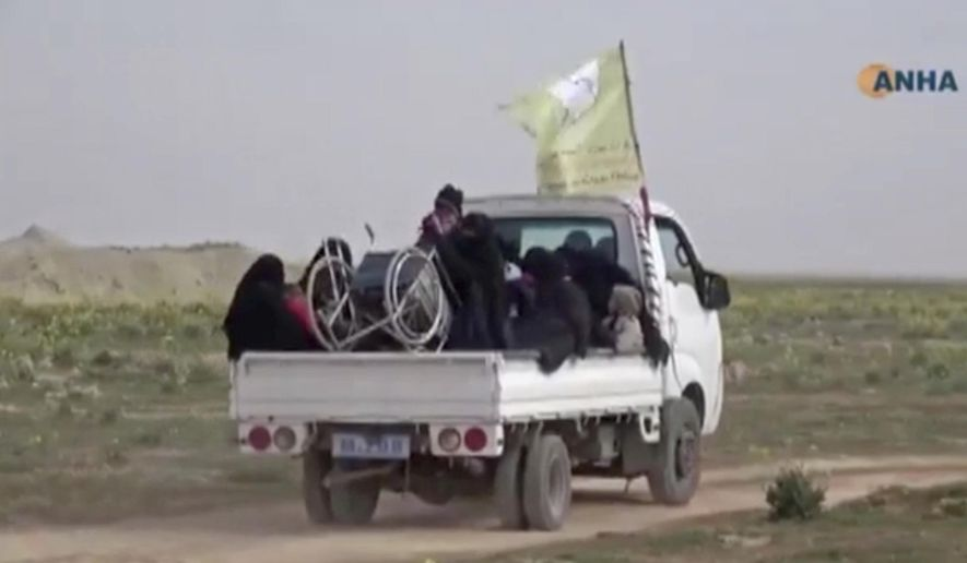 "In this Sunday, Feb. 10, 2019, image from video provided by Hawar News Agency, ANHA, an online Kurdish news service, civilians flee fighting near Baghouz, Syria. Fierce fighting was underway Monday between U.S.-backed Syrian forces and the Islamic State group around the extremists' last foothold in eastern Syria. The capture of the IS-held village of Baghouz and nearby areas would mark the end of a four-year global war to end IS' territorial hold over large parts of Syria and Iraq, where the group established its self-proclaimed ""caliphate"" in 2014. (ANHA via AP)"