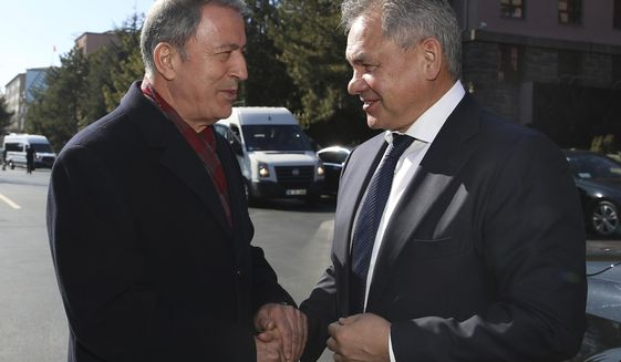 "Turkish Defence Minister Hulusi Akar, left, and Russia's Defence Minister Sergei Shoigu greet each other before their talks in Ankara, Turkey, Monday, Feb. 11, 2019. Shoigu said at the start of Monday's meeting with his Turkish counterpart Akar that the two countries' experts have done ""a lot of work to coordinate on issues related to the stabilization in Idlib and issues related to the east bank of the Euphrates River."" (Defence Ministry via AP, Pool)"