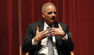 Former Attorney General Eric Holder speaks at Drake University, Tuesday, Feb. 12, 2019, in Des Moines, Iowa. (AP Photo/Charlie Neibergall) ** FILE **