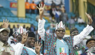 In this Saturday, Feb. 9, 2019, file photo, Nigeria's incumbent President Muhammadu Buhari of the All Progressives Congress Party, center, gestures during an election campaign rally at the Teslim Balogun stadium in Lagos, Nigeria. Nigeria's government is acknowledging a resurgence of Islamic extremist violence. The near-daily attacks have many traumatized Nigerians questioning whether they can vote for President Muhammadu Buhari on Saturday, Feb. 16, 2019, as he seeks a second term. (AP Photo/Sunday Alamba, File)