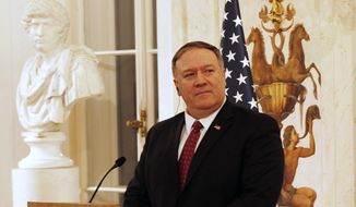 U.S. Secretary of State Mike Pompeo at a news conference with Polish Foreign Affairs Minister at Lazienki Palace, during his visit to Warsaw, Poland, Tuesday, Feb. 12, 2019. (AP Photo/Czarek Sokolowski)