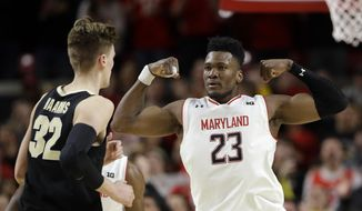 Maryland forward Bruno Fernando (23) gestures in front of Purdue center Matt Haarms during the second half of an NCAA college basketball game Tuesday, Feb. 12, 2019, in College Park, Md. Fernando contributed 12 points to Maryland's 70-56 win. (AP Photo/Patrick Semansky) ** FILE **